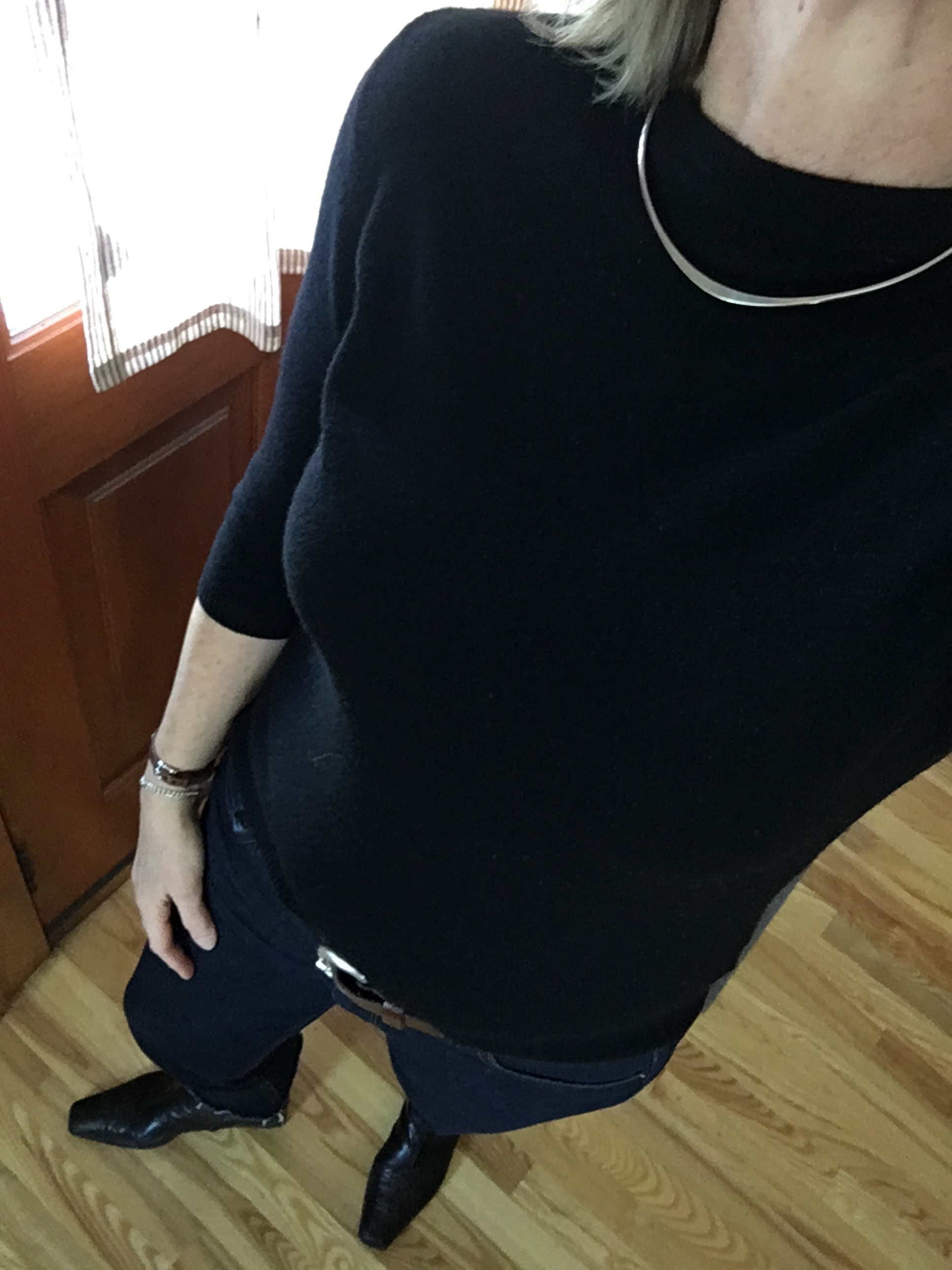 black cashmere sweater with silver choker necklace