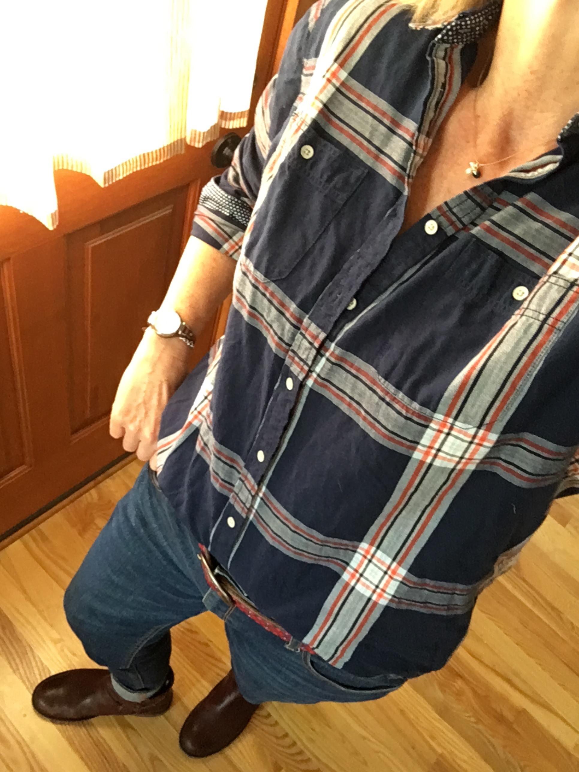 plaid shirt and dark wash denim