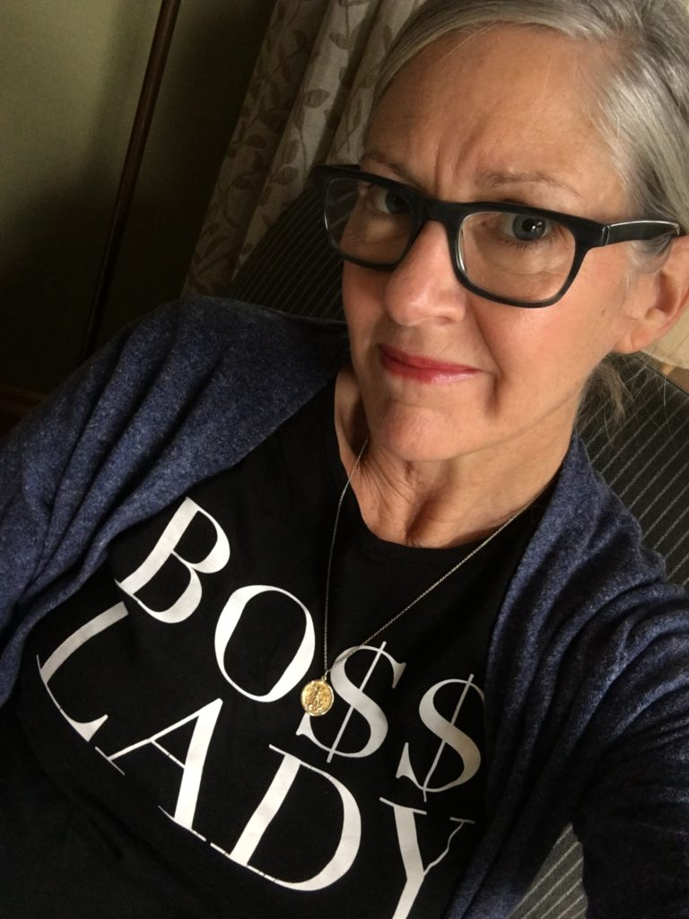 "Nancy boosts her mojo by wearing a ""Boss Lady"" graphic tee"