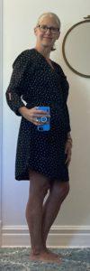 nancy wears a black polkadot housedress_sideview