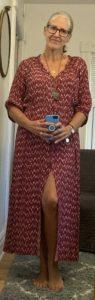 nancy wears a red chevron-print housedress
